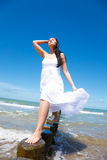 Relaxed balance woman. Female relaxing on coast growing success balance Stock Photos