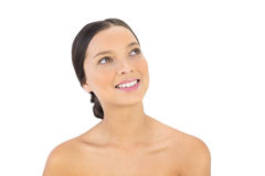 Relaxed bare brunette posing looking up Royalty Free Stock Image