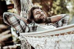 Relaxed bearded man chilling in the park