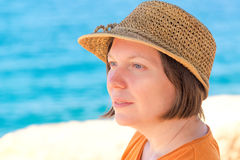 Relaxed beautiful adult caucasian woman with straw hat, head por Royalty Free Stock Image