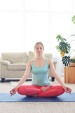 Relaxed beautiful woman having rest in lotus asana Royalty Free Stock Photography