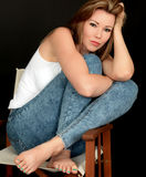 Relaxed Beautiful Young Woman Sitting in a Chair Stock Photos