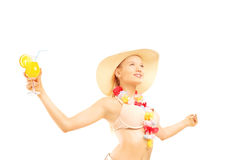 Relaxed blond female in bikini holding a cocktail and looking up Stock Photo
