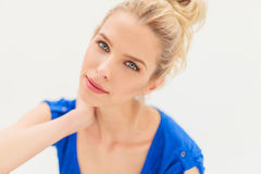 Relaxed blonde woman with blue eyes Stock Images