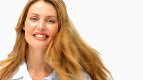 Relaxed blonde woman looking at the camera stock video footage