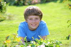 Relaxed boy. Portrait of a relaxed young teenage boy in the garden Royalty Free Stock Photography