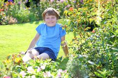 Relaxed boy. Portrait of a relaxed young teenage boy in the garden Royalty Free Stock Photos