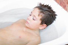 Relaxed boy in bath Royalty Free Stock Photo