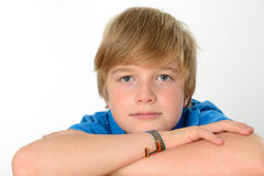 Relaxed boy. Boy in blue shirt is looking relaxed Stock Photography