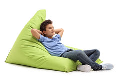 Relaxed boy laying on a beanbag Stock Photo