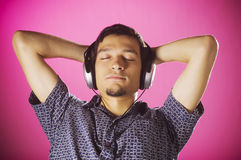 Relaxed boy listening music Stock Photography