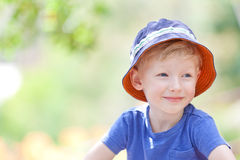 Relaxed boy. Portrait of a relaxed smiling boy in a sunhat Royalty Free Stock Photos