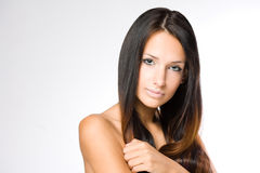 Relaxed brunette beauty. Stock Image