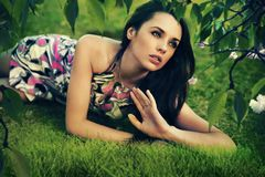 Relaxed brunette in garden Royalty Free Stock Photography