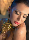 Relaxed brunette lady with golden skin. Relaxed brunette woman with golden skin Stock Photos