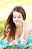 Relaxed brunette outdoors Stock Image