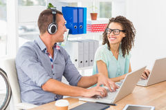 Relaxed business colleagues looking each other Stock Photography