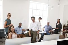 Relaxed business colleagues in their office smile to camera royalty free stock photography