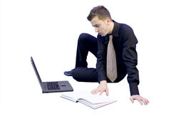 Relaxed business man on the floor Royalty Free Stock Image