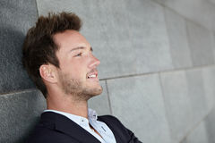 Relaxed business man leaning head Stock Photography
