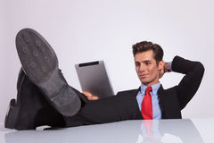 Relaxed business man reads pad stock images