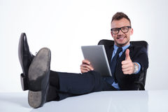 Relaxed business man shows ok sign Stock Image
