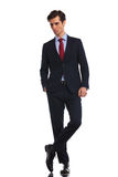 Relaxed business man standing with legs crossed Royalty Free Stock Photography