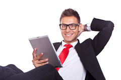 Relaxed business man using electronic pad tablet Royalty Free Stock Photography
