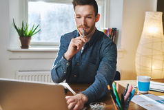 Relaxed business man working on laptop Royalty Free Stock Photo