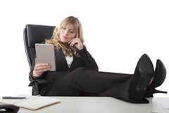 Relaxed business woman holding a tablet Stock Photography