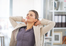 Relaxed business woman in office Stock Photo