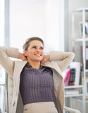 Relaxed business woman in office. Portrait of relaxed business woman in office Stock Photo