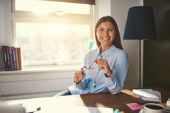 Relaxed business woman sitting at desk Stock Images