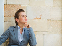 Relaxed business woman sitting on terrace Stock Images