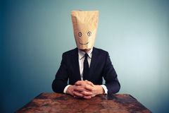Relaxed businessman with bag over head Royalty Free Stock Photo