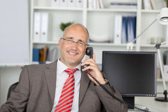 Relaxed businessman calling by phone Royalty Free Stock Image