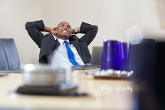 Relaxed businessman daydreaming Stock Photography