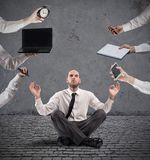 Relaxed businessman that does yoga during the work Royalty Free Stock Images