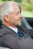 Relaxed businessman driving cabriolet Royalty Free Stock Image