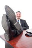 Relaxed businessman with feet on desk Royalty Free Stock Photos