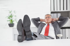 Relaxed businessman with his feet up Royalty Free Stock Photo