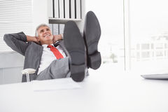 Relaxed businessman with his feet up Royalty Free Stock Images