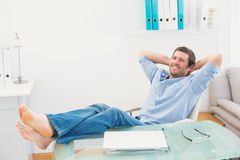 Relaxed businessman with his feet up Royalty Free Stock Photos