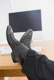 Relaxed businessman with his feet up Stock Image
