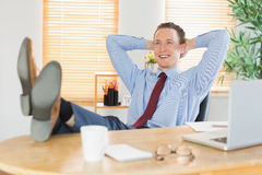 Relaxed businessman with his feet up Stock Photos