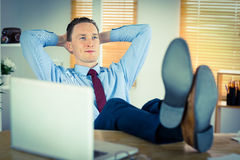 Relaxed businessman with his feet up Royalty Free Stock Image