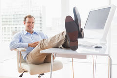 Relaxed businessman with his feet up Stock Images
