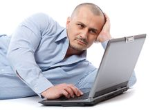 Relaxed businessman at his laptop Stock Images