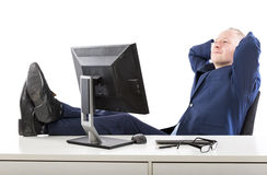 Relaxed businessman at his office Stock Images