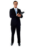 Relaxed businessman holding a folder Royalty Free Stock Images